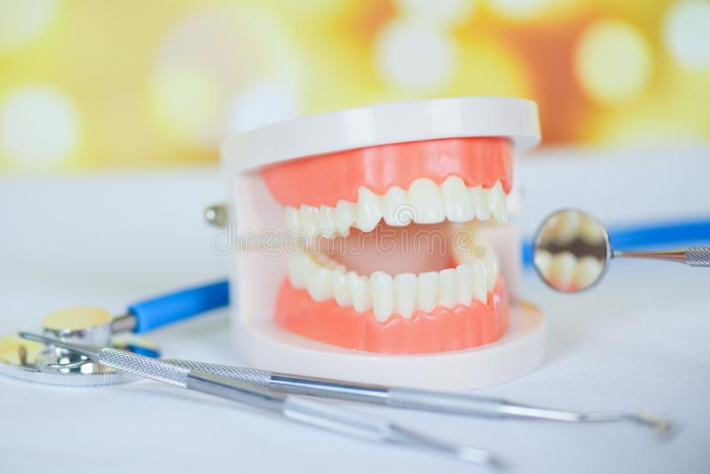Dentist tools with dentures dentistry instruments and dental hygienist checkup concept with teeth model and mouth mirror oral stock photos