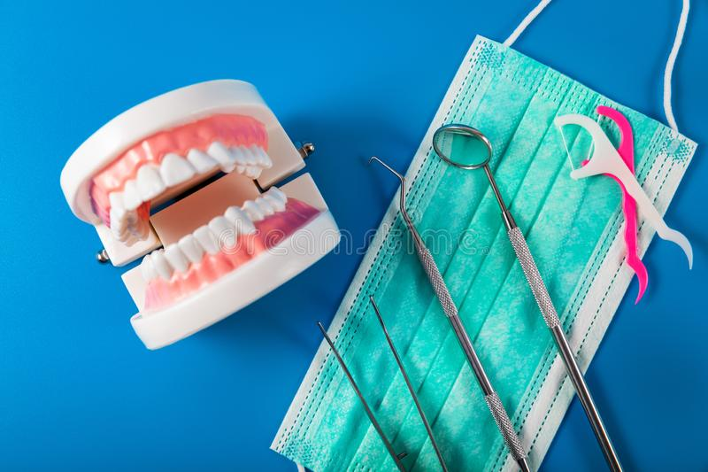 Dentist tools and equipment on blue background. Top view royalty free stock image