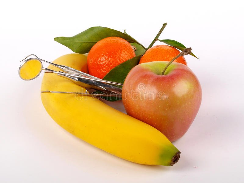 Dentist tools and fruit stock image