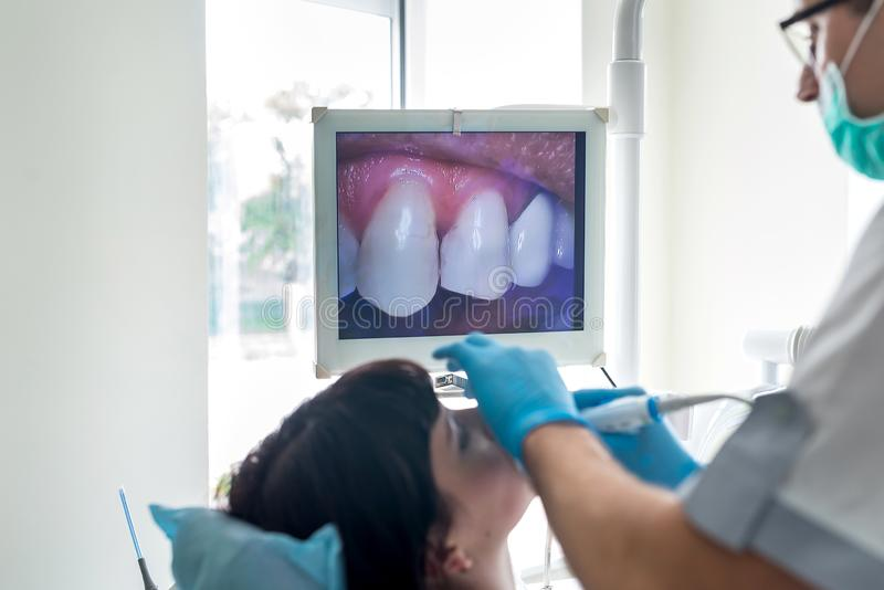 dentist using the camera shows health problems royalty free stock photos