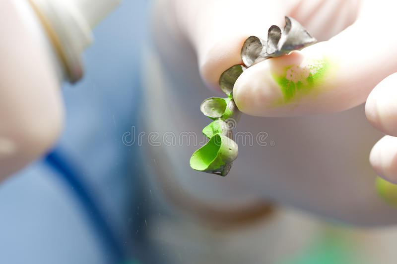 Download Dentist Using Occlusal Spray On Fixed Denture Stock Image - Image: 13566299