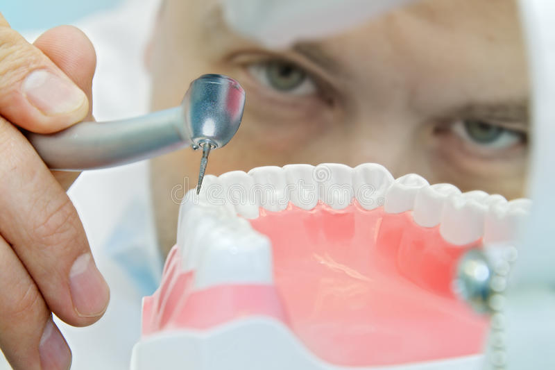 Dentist at work stock photo