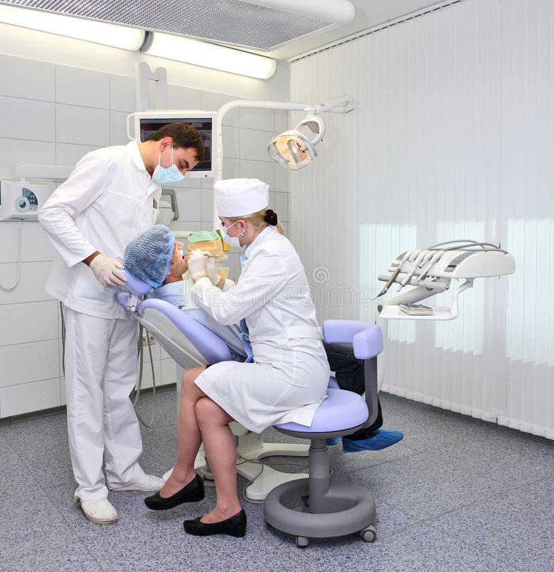 Dentist at work in dental room royalty free stock photos