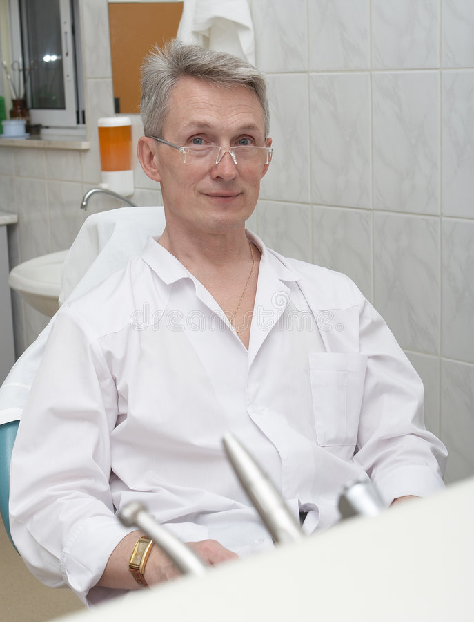 Dentist on a workplace 3 royalty free stock photos