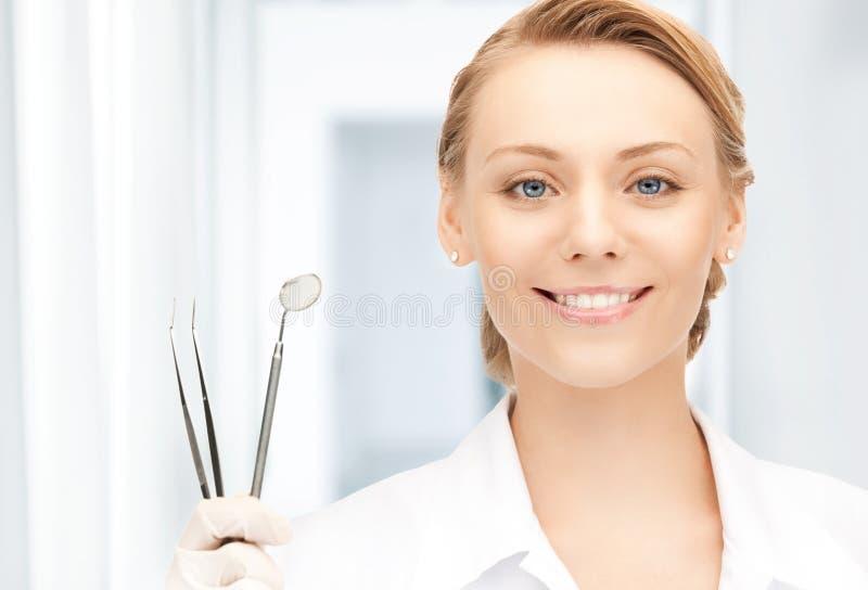 Dentista com ferramentas foto de stock