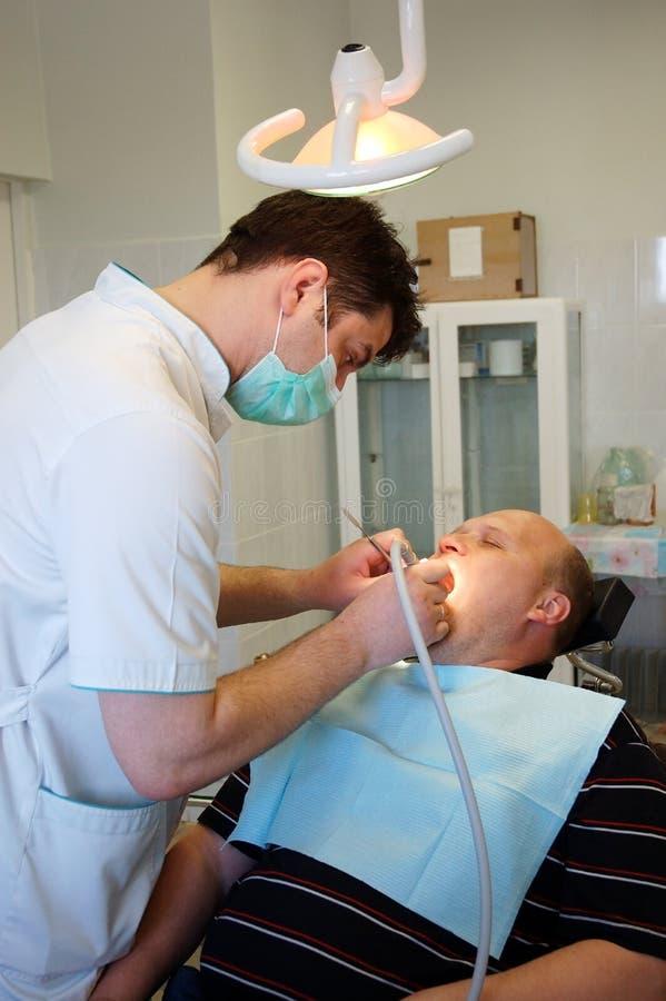 Dentista e paziente fotografia stock libera da diritti