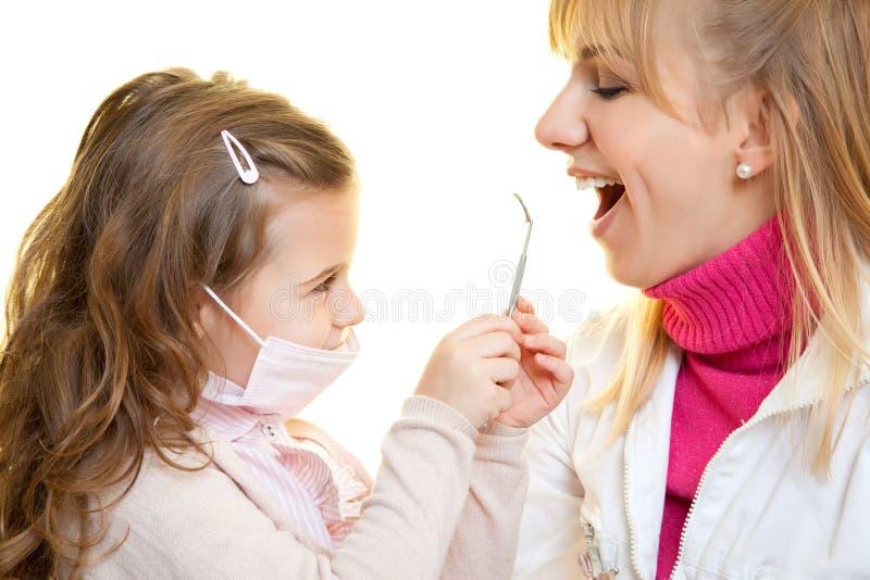 Dentista e paziente fotografia stock