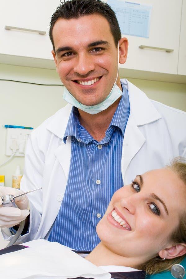 Dentista y paciente foto de archivo