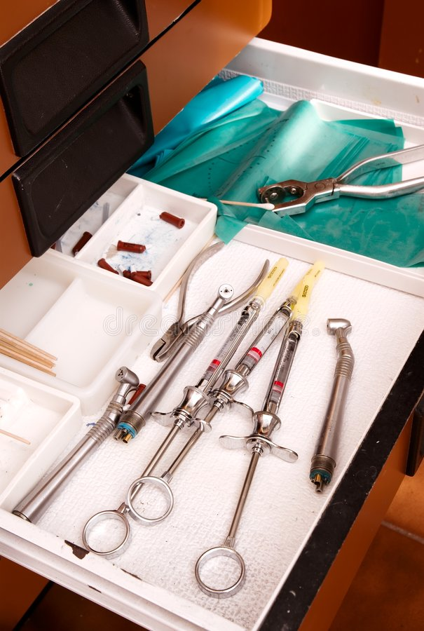 Dentists tools in drawer for novicane royalty free stock photos