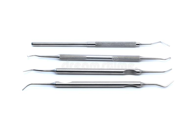 Dentists tools: four dental explorers isolated on a white background. Dental hygiene and healthcare concept stock images