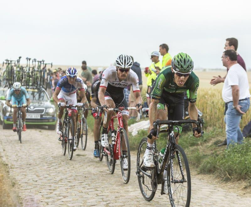 Dentro do Peloton em uma estrada da pedra - Tour de France 2015 fotografia de stock royalty free