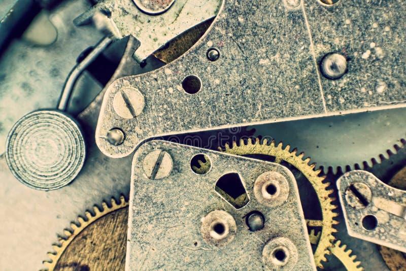 Dentro do relógio de bolso Mecanismo do pulso de disparo com macro Backgrou das engrenagens fotos de stock