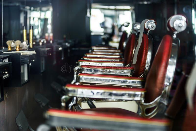 denutformade barberaren shoppar arkivfoto