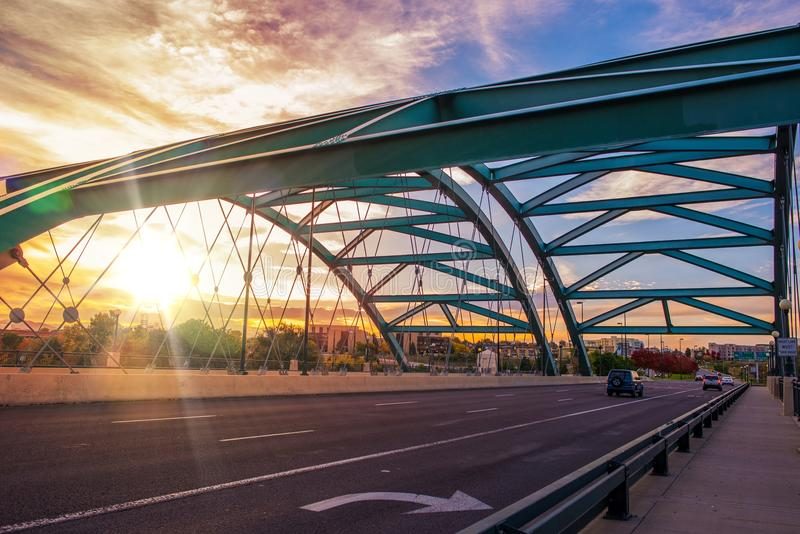 Denver Bridge Traffic. Speer Boulevard Bridge at Sunset. Bridge Traffic. City of Denver, United States royalty free stock photo