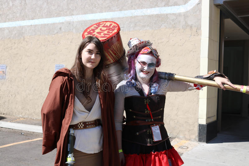 Denver, Colorado, USA - July 1, 2017: Jedi knight and Harley Quinn at Denver Comic Con. Two females in costume as a Jedi Knight and Harley Quinn at Denver Comic stock image