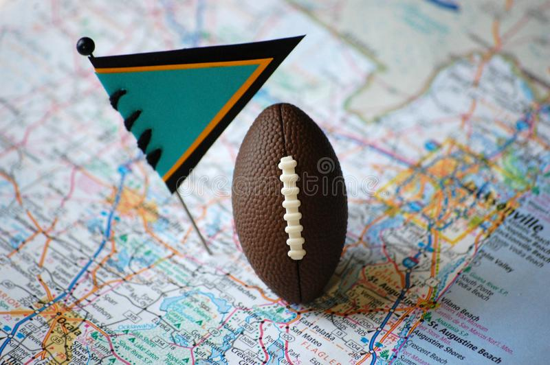 Jacksonville. Macro shot of a flag and football placed on , Colorado in a map, american, athlete, atlas, attraction, background, blue, bowl, broncos royalty free stock photography