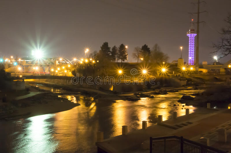 Denver's Water Fall and Sparkling Night Lights. Confluence Park is an urban park encompassing the confluence of Cherry Creek and the South Platte River in Denver royalty free stock images