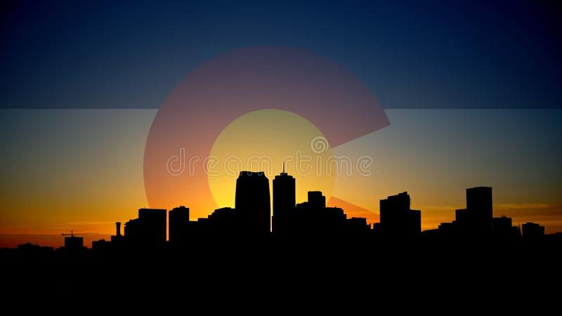 Denver Skyline Night Silhouette with Colorado Flag in Sky. Silhouette of the downtown Denver skyline, with Colorado Flag in sky royalty free stock photo