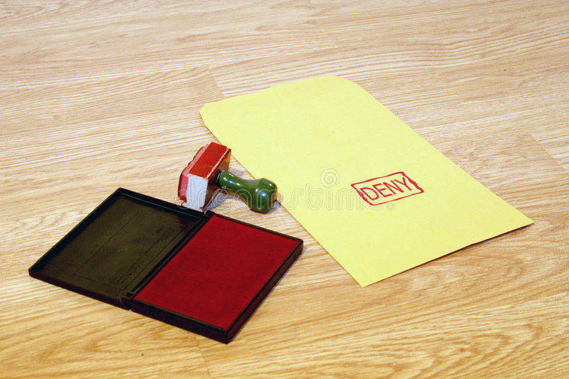 Deny. Office series with stamp and pad on desk with manila envelope. Room for text or logo stock photos