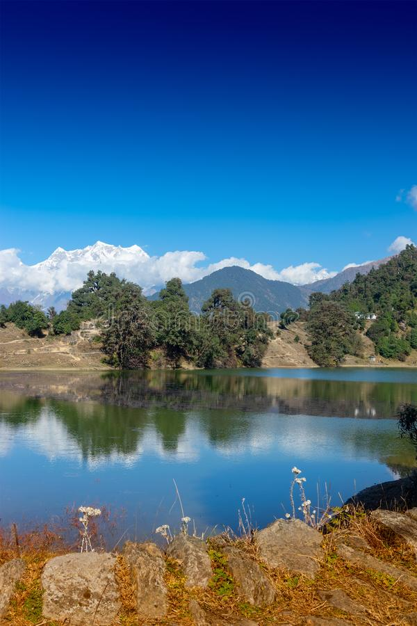 Deoria tal, uttarakhand, India. Deoria Tal , also Devaria or Deoriya is a high altitude lake in Uttarakhand, India. Blue sky with snow-covered mountains stock image