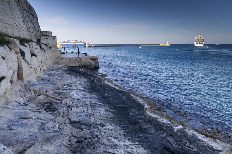 Depart. Big tourist ship depart in the main harbor, Malta stock images