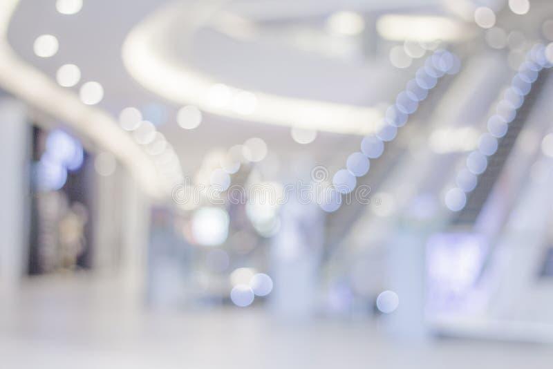 departamento interior borroso, fondo ligero blanco del centro comercial fotos de archivo libres de regalías