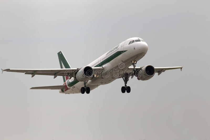 Departing Alitalia Airbus A320-216 aircraft royalty free stock photo