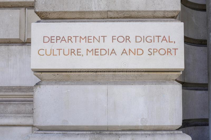 Department For digital, Culture, Media and Sport sign on the Whitehall Government department building. Whitehall, Westminster, London, UK - June 8, 2018: Stone stock image