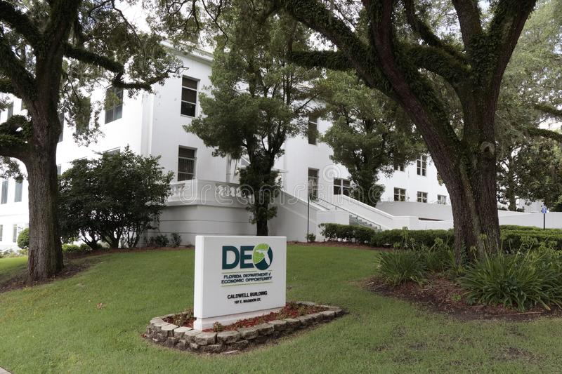 Department of Economic Opportunity Sign and Building in Downtown. Tallahassee, FL, USA - July 15, 2018: Front sign and exterior facade of the Department of royalty free stock image