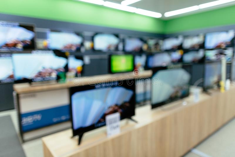 Department of plasma TV in electronic store. Television Retail store. Blurred photo stock photo