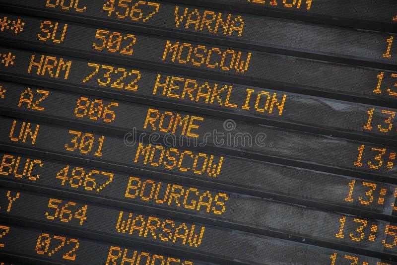 Departure/Arrivals board at International Airport. Departure/Arrivals board with different city names at International Airport stock photo