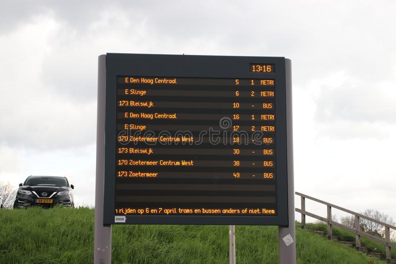 Departure board at rainstadrail station Rodenrijs for fast commuter trains beween Den Haag and Rotterdam. Departure board at rainstadrail station Rodenrijs for stock images