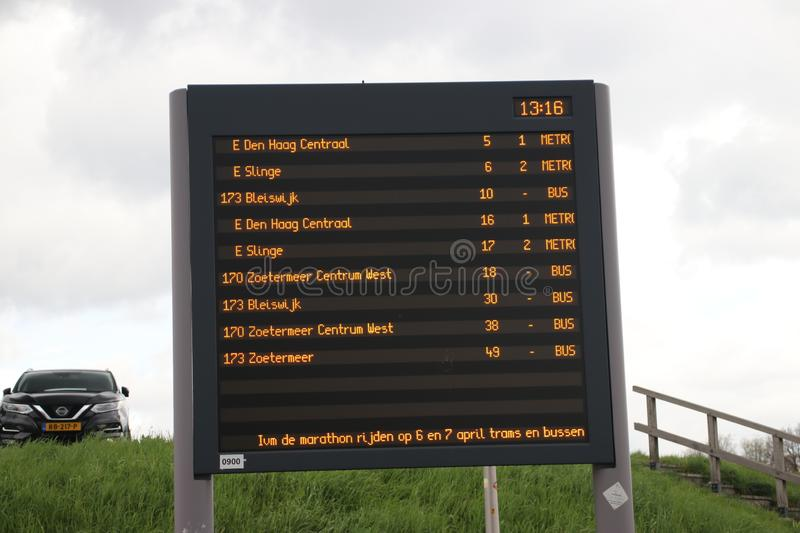 Departure board at rainstadrail station Rodenrijs for fast commuter trains beween Den Haag and Rotterdam. royalty free stock image