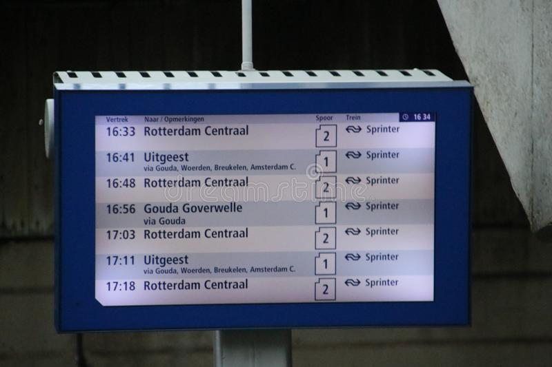 Departure board on train station in the Netherlands stock image