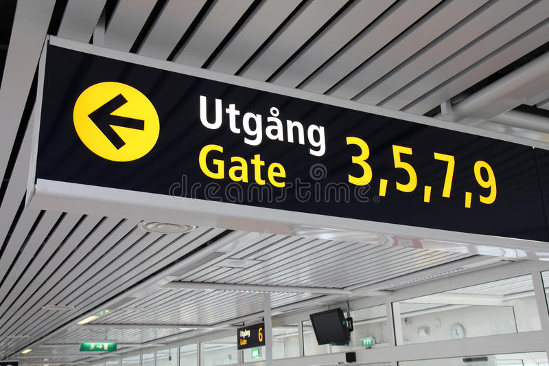 Departure gates. Typical illuminated directions sign in a modern international airport. Malmo Airport terminal - English and Swedish language royalty free stock images