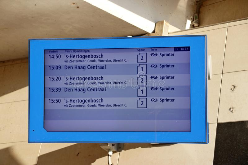 Departure information display at train station Den Haag Ypenburg in The Hague in the Netherlands. royalty free stock image