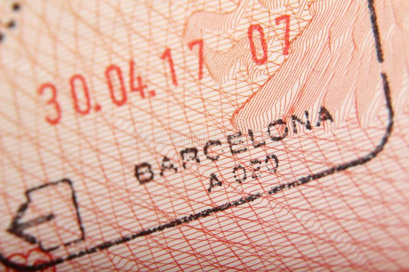 Departure stamp in a passport from Barcelona airport stock photos