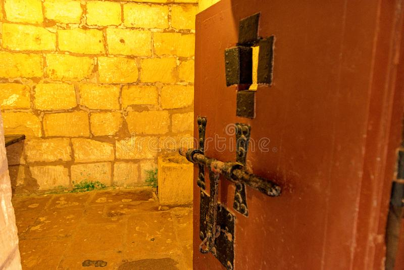 Depiction of Maltese Cross on the wall of the cell in Old Prison of Rabat Citadel, in Victoria. VICTORIA, MALTA - MAY 15, 2019: Depiction of Maltese Cross on the royalty free stock photography