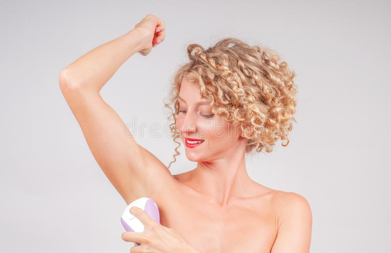 Depilation, hair removal and skin care concept. Depilation armpit, hair removal and skin care concept stock photos
