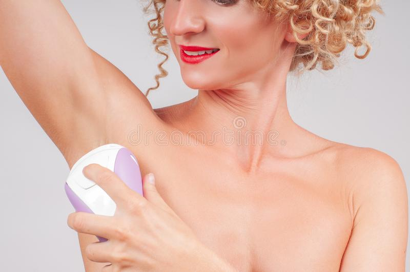 Depilation, hair removal and skin care concept. Depilation armpit, hair removal and skin care concept stock photography