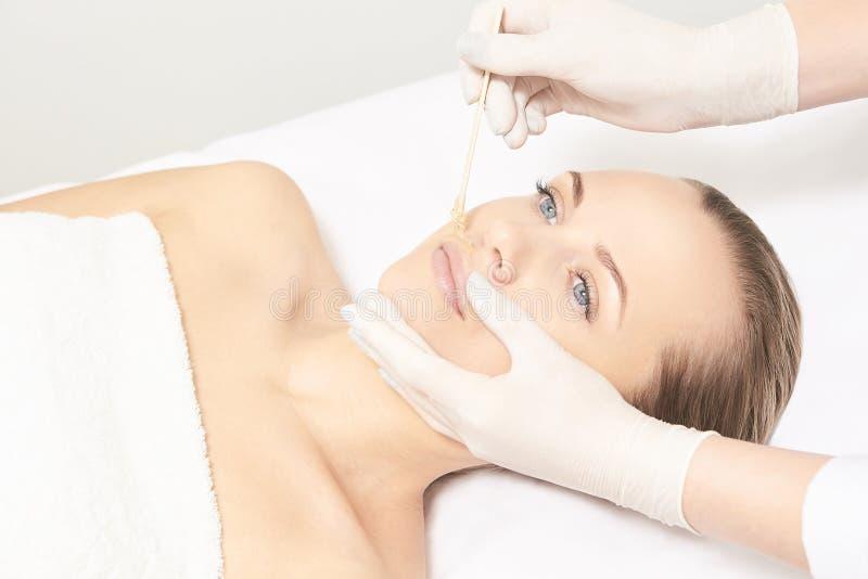 Depilation spa procedure. Woman hair remove waxing. Epilation sugaring. Lip mustache stock photos