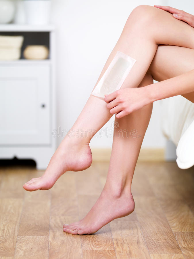 Download Depilation With Waxing On The Woman's Legs Stock Photo - Image: 15089944