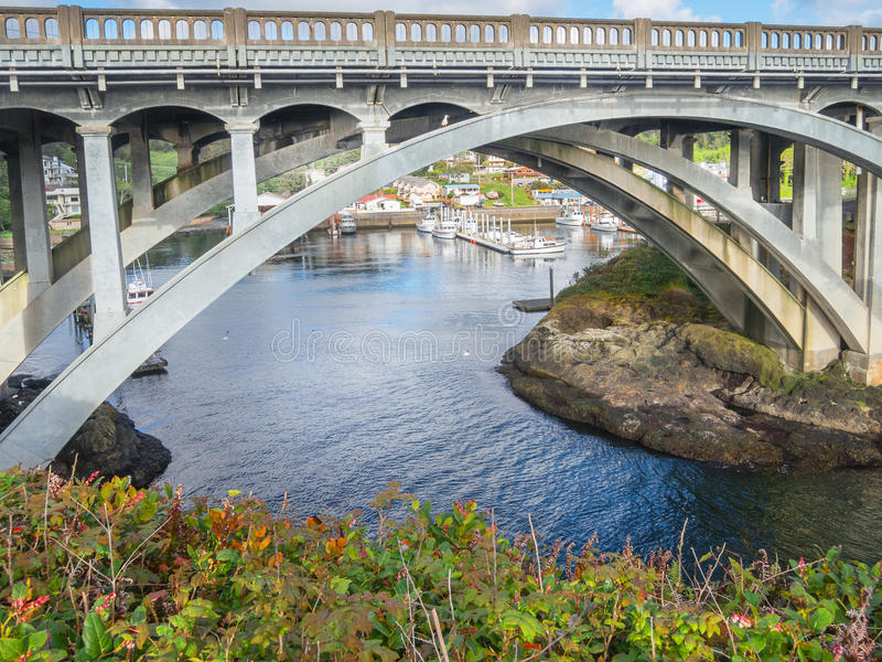Depoe Bay, Oregon. View of Depoe Bay, Oregon harbor and the Highway 101 bridge stock images