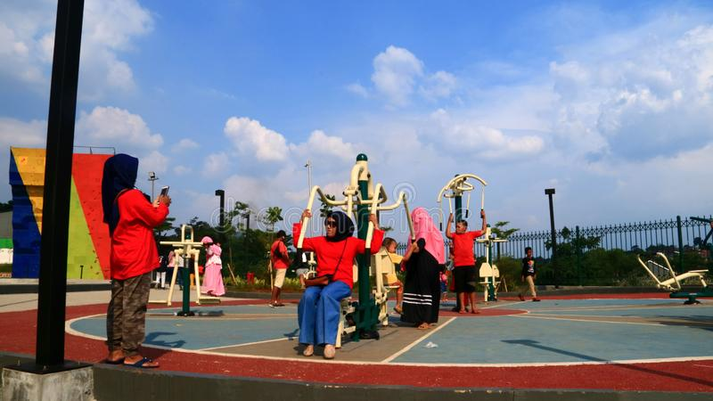 Outdoor Gym in Depok. Depok, Indonesia - April 14, 2019: People at outdoor gym in Alun-Alun green open space at Grand Depok City, West Java stock photography