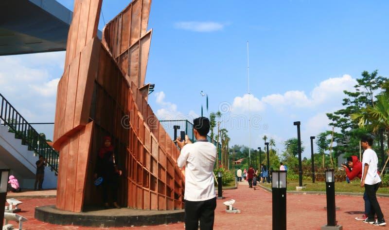 Alun Alun Depok. Depok, Indonesia - April 14, 2019: Visitors take pictures at Alun-Alun Depok green open space in Grand Depok City, West Java royalty free stock image