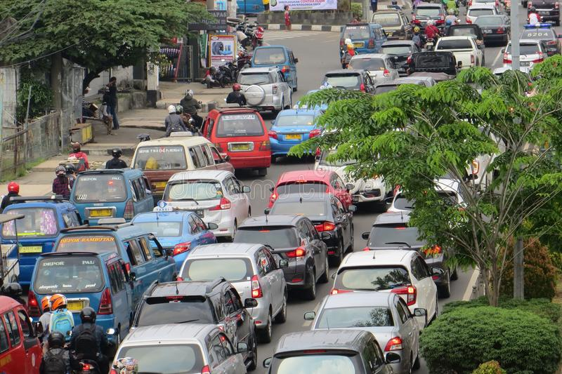 Crowded street in Depok. DEPOK, INDONESIA - March 10, 2017: Congested traffic on Jalan Margonda stock photography