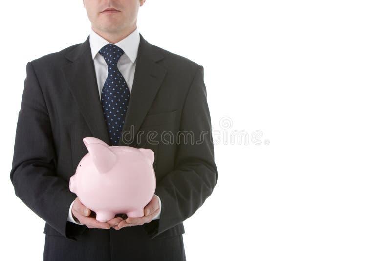 deponować pieniądze biznesmena mienia prosiątko fotografia royalty free