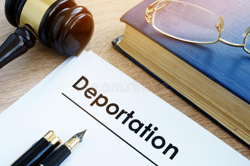 Deportation and other documents. Immigration law. Deportation and other documents on a desk royalty free stock photo