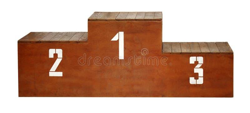 Deporte Podio de madera con los números blancos imagenes de archivo