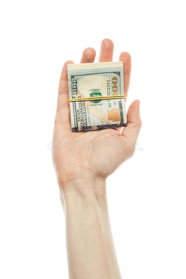 Deposit interest, financial USA money banknote and commercial money investment profit concept. US dollars cash money in male hand. Isolated on white stock photography